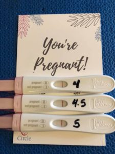 """Three pregnancy test and a card that reads """"You're Pregnant!"""""""