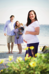 Surrogate mother with intended parents at beach