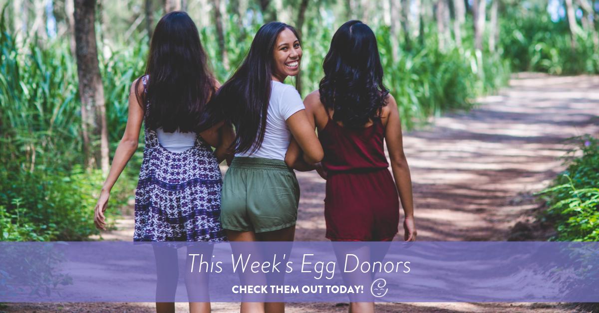 Three egg donors walking down dirt path