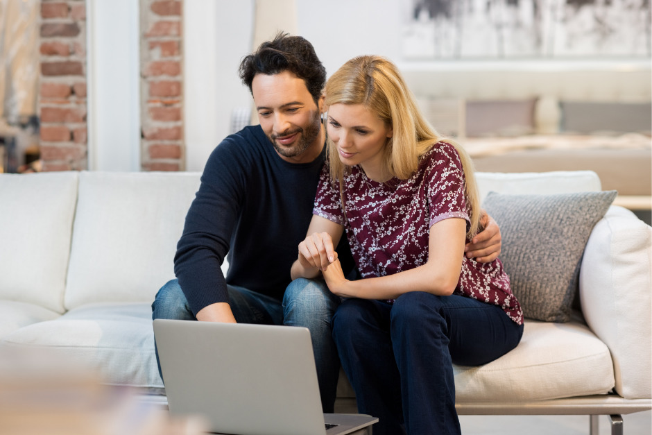 Husband and wife researching surrogacy